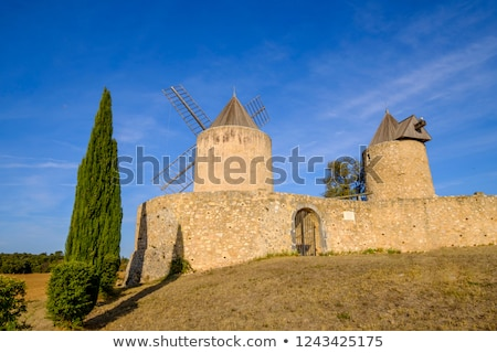 windmills in regusse provence france stock photo © phbcz