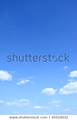 Cloudscape with blue sky above vertical image. Stock photo © tuulijumala