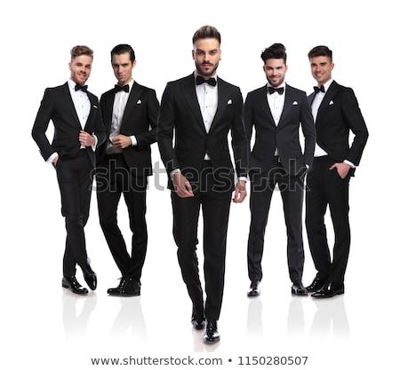 full body pictrue of a man in tuxedo walking forward  Stock photo © feedough