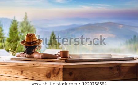 Jonge vrouw ontspannen hot tub water gezondheid zwembad Stockfoto © boggy