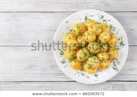 Hot boiled potato on rustic background  Stock photo © Yatsenko