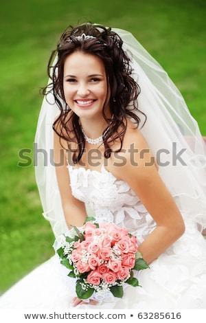 Jonge mooie bruid poseren buitenshuis camera Stockfoto © tekso
