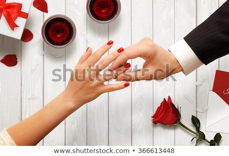férfi · nő · gyűrű · térd · park · mosoly - stock fotó © wavebreak_media