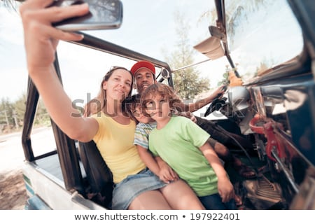 Portrait of woman with man sitting on off road vehicle Stock photo © wavebreak_media