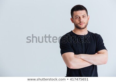 Sportsman standing with arms folded and looking at camera Stock photo © deandrobot