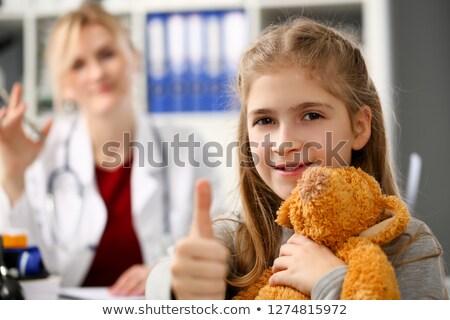 Genç kafkas çocuk doktoru oyuncak ayı doktor Stok fotoğraf © RAStudio