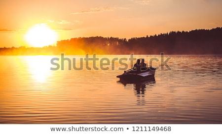 Kadın adam kürek çekme tekne göl sevmek Stok fotoğraf © IS2