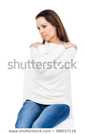 Desperate woman crossing arms on shoulders on white background Stock photo © wavebreak_media