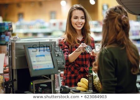 Pénztáros áll pénztár áruház fiatal férfi Stock fotó © RAStudio