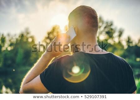 Man talking on mobile phone in park Stock photo © stevanovicigor