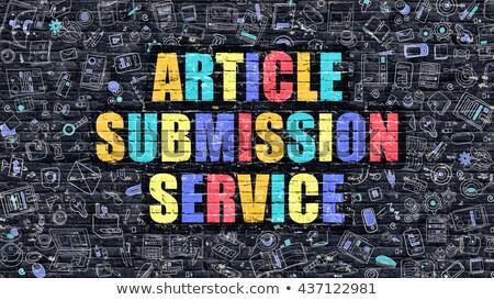 Multicolor Article Submission Service on Dark Brickwall.  Stock photo © tashatuvango