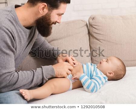 Baba rahatlatıcı ağlayan bebek aile sevmek Stok fotoğraf © IS2