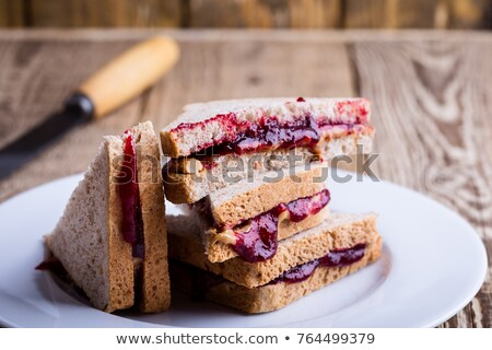 rustic american peanut butter and jelly sandwich stock photo © zkruger