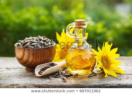 Napraforgóolaj üveg bögre magok virágok napraforgó Stock fotó © Illia