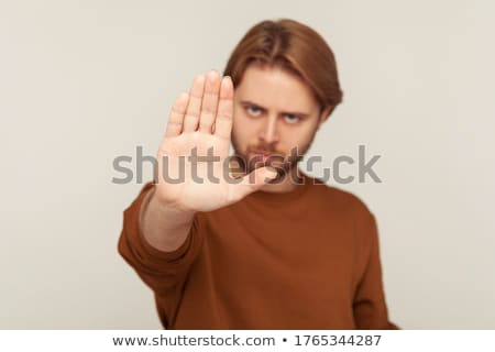 Confident man blocking negative emotions and stress Stock photo © ichiosea