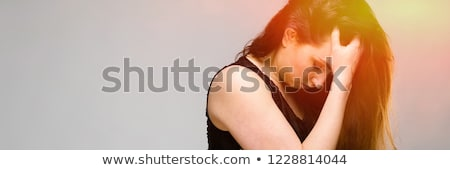 Emotional pretty upset bewildered plus size model standing in studio showing stop sign on gray backg Stock photo © Traimak