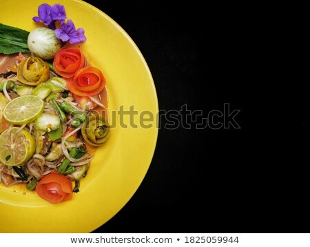 spices and tomatoes around fish stock photo © dash