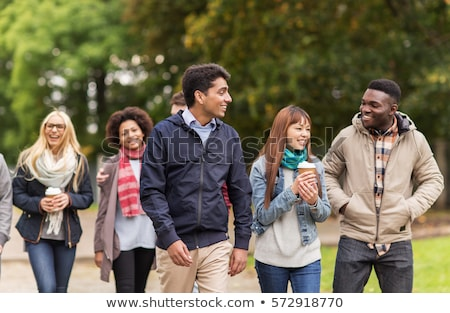 Multiracial young people walking in the autumn park Stock photo © boggy