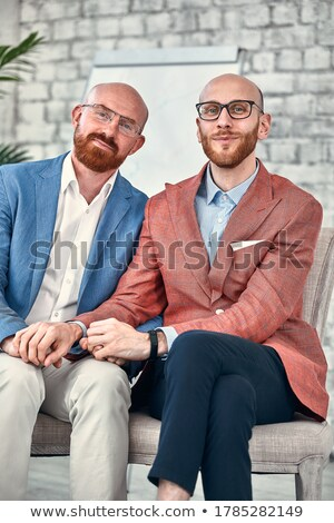 Portrait of an irritated young couple dressed in sweaters Stock photo © deandrobot