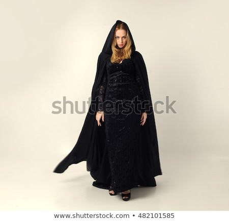 Full length image of scary witch woman wearing black costume and Stock photo © deandrobot