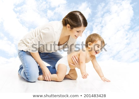 mother with baby over sky background Stock photo © dolgachov