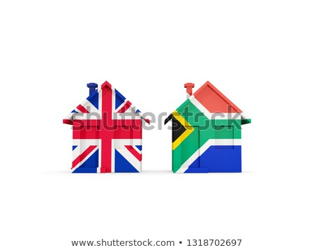 Two houses with flags of United Kingdom and south africa Stock photo © MikhailMishchenko