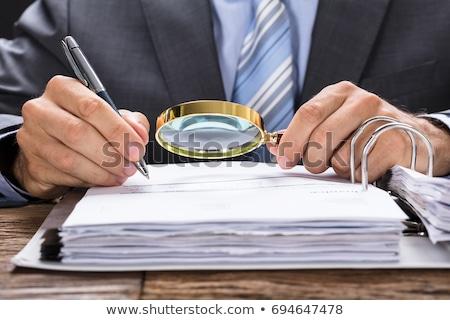 Businessman Examining The Invoice Document Stock photo © AndreyPopov