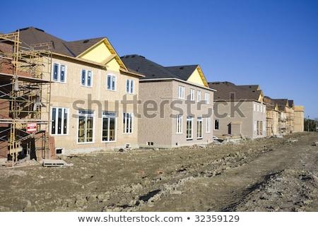 ストックフォト: City Landscape With New Houses Under Construction On A Background Of Cloudy Sky With Sunnlight Aeri