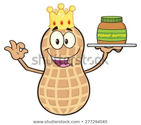 funny king peanut cartoon character holding a jar of peanut butter stock photo © hittoon