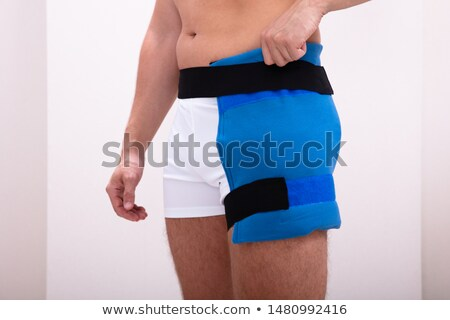 Person Wearing Thigh Ice Pack Stock photo © AndreyPopov
