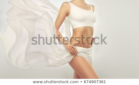 Stock photo: Perfect slim young body. Sports , fitness or plastic surgery and aesthetic cosmetology. Beautiful wo