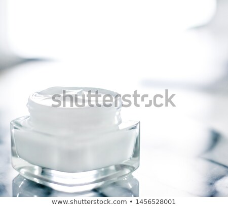 Moisturizing beauty face cream on blue marble stone, skincare an Stock photo © Anneleven