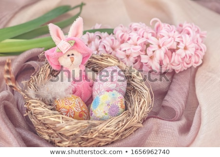 Paaseieren stro nest chocolade Pasen vakantie Stockfoto © dolgachov