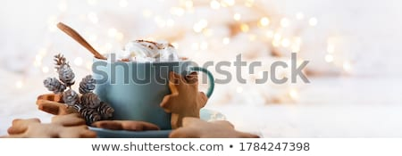 Banner of Cup of coffee, cappuccino with chocolate cookies and biscuits on black table background. Stock photo © Illia