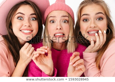 Portrait closeup of three excited girls wondering and looking at Stock photo © deandrobot