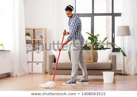 indian man with mop and bucket cleaning at home Stock photo © dolgachov