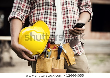 a construction worker holding pliers stock photo © photography33