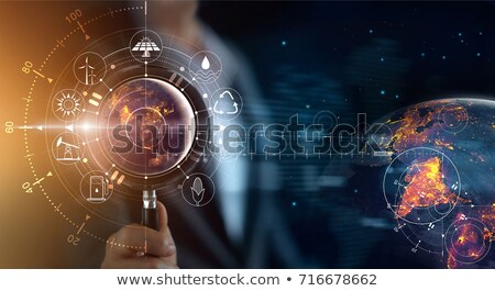 Man holding a globe and a sign for energy consumption Stock photo © photography33