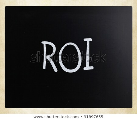 The word 'ROI' handwritten with white chalk on a blackboard stock photo © nenovbrothers