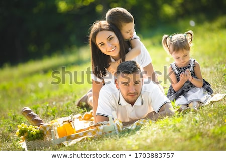 cute kid and pretty mom outdoors at fall stock photo © lithian