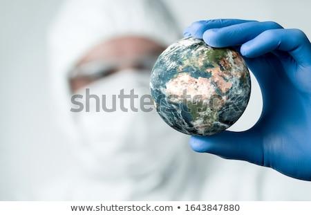 Doctor holding globe Stock photo © photography33
