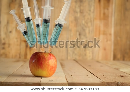 apple gmo apple and syringe stock photo © shutswis