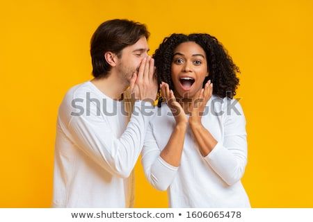 young man whispering a secret into a womans ear stock photo © photography33