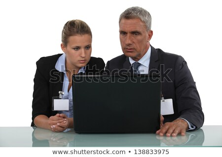 workers wearing badge in front of a computer stock photo © photography33