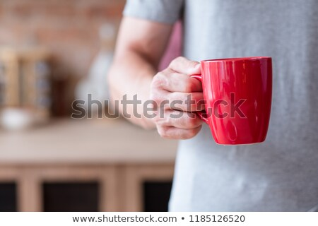 Man with red coffee cup Stock photo © photography33