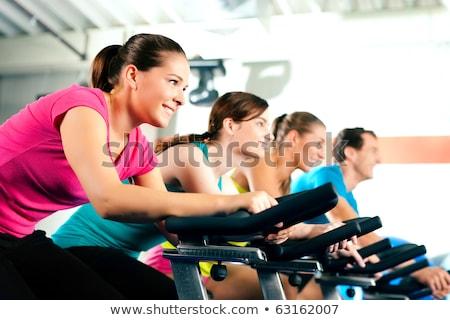 люди · спортзал · осуществлять · Велосипеды · спорт - Сток-фото © wavebreak_media