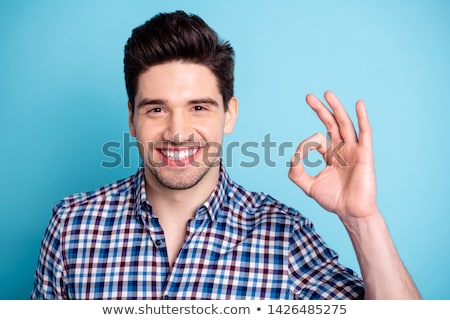Stock photo: portrait of cute handsome man giving a friendly advice
