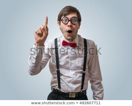 Nerd bem vestir moço olhando sorridente Foto stock © silent47