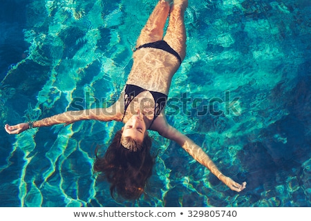 Wellness - young woman floating in Spa or swimming pool  Stock photo © Kzenon