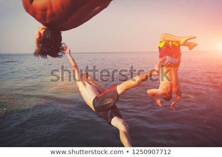Fiatal felnőtt snorkeling folyó védőszemüveg búvár víz Stock fotó © aetb